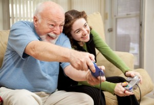 Grandpa and Teen Play Video Games