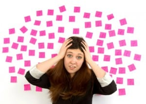 Decision making young woman  with pink sticky notes, question mark