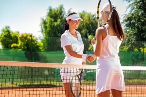 Tennis players giving handshake