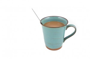 ceramic mug cups of hot chocolate with spoon inside