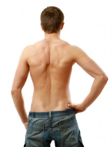 Back view of sexy muscular man, isolated on white background