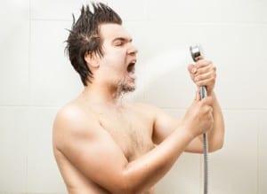 Portrait of funny man singing at shower